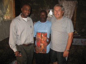Pastor Zacharie with Wilfrid and Nelson receiving evangelism materials