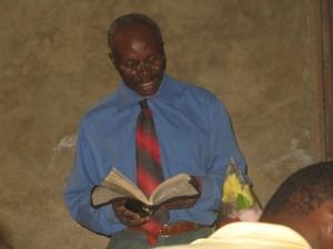 Pastor Zacharie preaching