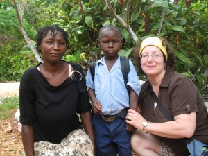 Crystal with her sponsored child Dieumile and his mother